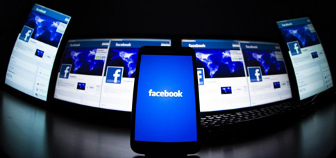 The loading screen of the Facebook application on a mobile phone is seen in this photo illustration taken in Lavigny May 16, 2012. Facebook Inc increased the size of its initial public offering by almost 25 percent, and could raise as much as $16 billion as strong investor demand for a share of the No.1 social network trumps debate about its long-term potential to make money. Facebook, founded eight years ago by Mark Zuckerberg in a Harvard dorm room, said on Wednesday it will add about 84 million shares to its IPO, floating about 421 million shares in an offering expected to be priced on Thursday. REUTERS/Valentin Flauraud (SWITZERLAND - Tags: BUSINESS SCIENCE TECHNOLOGY SOCIETY TPX IMAGES OF THE DAY)