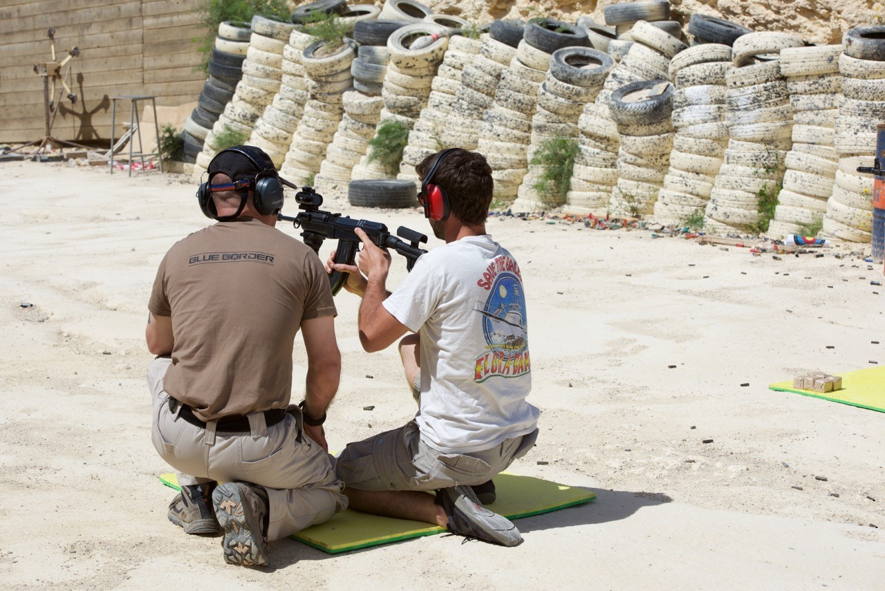 A moment of the activity: shooting a carbine.